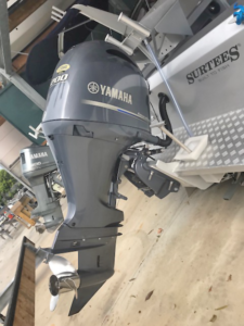 Yamaha Engines Hanging Off The Back Of Boats